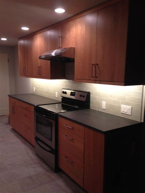 grey backsplash with cherry cabinets 17 best images about kitchen on black granite