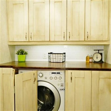 cabinet doors to hide washer and dryer built in washer and dryer keep it organized