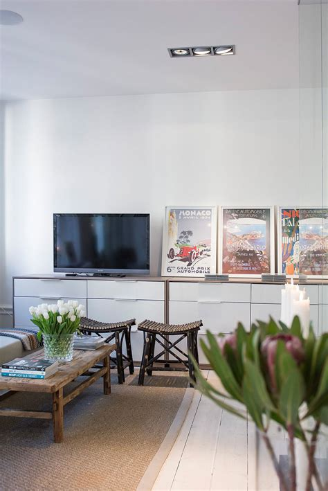 living room posters stylish and compact apartment in 214 stermalm stockholm