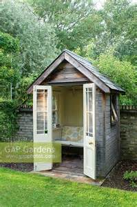 small sheds for backyard gap gardens small timber summer house with bench seat