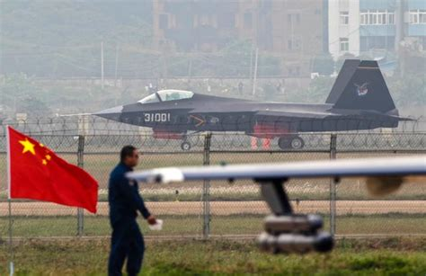 china s stealth fighter takes to the skies above air show the new york times