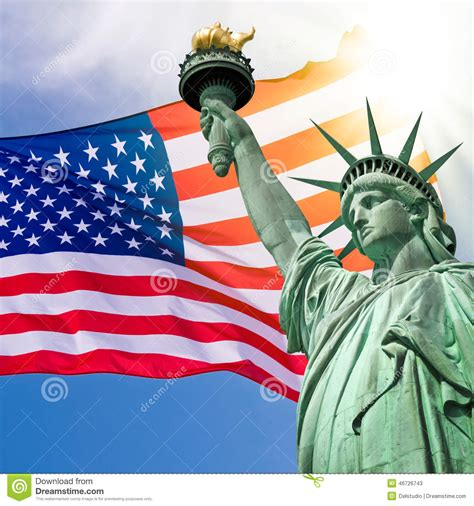 statue of liberty and flag statue of liberty sky and usa flag stock image