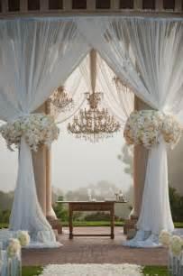 drapery with outdoor ceremony pillars simple wedding