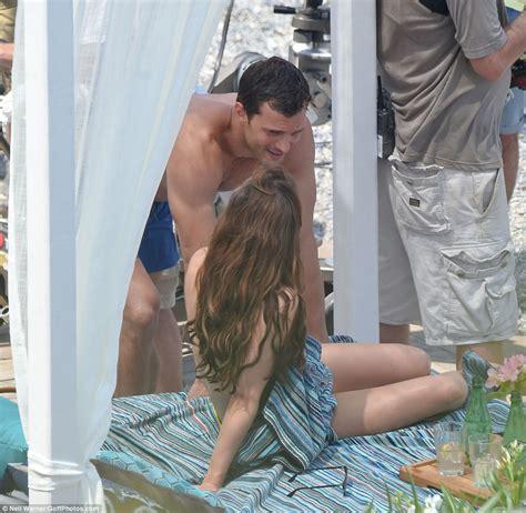 jamie dornan owl in a towel dakota johnson goes topless while filming racy fifty