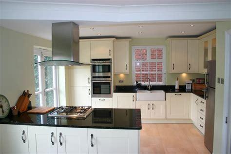 Shaker Kitchen With Granite Worktops by Woodgrain Finish Kitchen Installed In Reigate Surrey