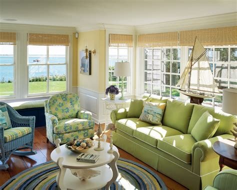 sliding french doors living room with green sofa and olive green sofa living room beach style with round rug