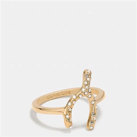 coach pave wishbone ring in metallic lyst