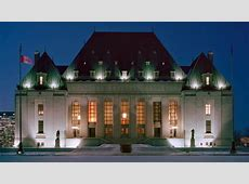 Night photo of front facade of the Supreme Court Justin Trudeau
