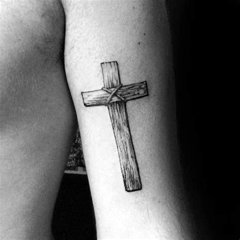 cross tattoo tricep 40 simple christian tattoos for men faith design ideas