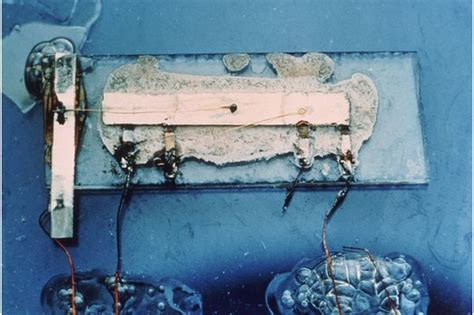 16 the integrated circuit was 7 16 wide and contained two transistors who invented it kilby demonstrates the 1st ic september 12 1958 edn