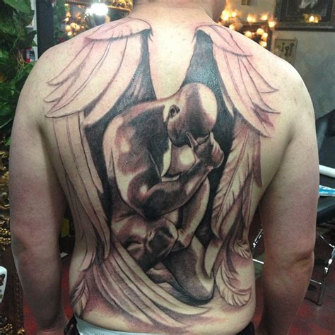 angel tattoo at the back 30 fallen angel tattoo ideas