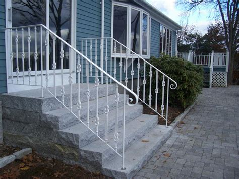 image of wrought iron exterior handrail including light