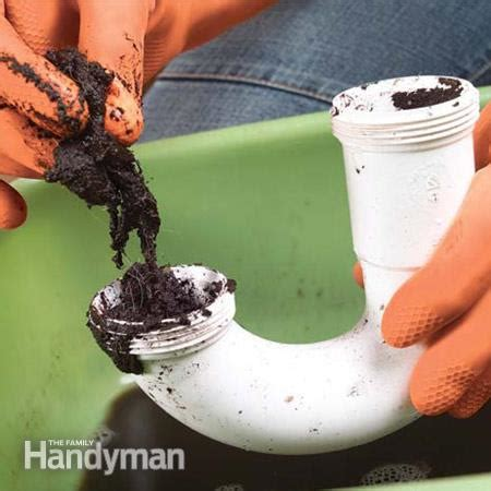 Clogged Kitchen Sink Drain Pipe How To Clear Clogged Sink Drains The Family Handyman