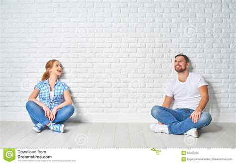 mortgage housing concept of mortgage housing problems couple at blank wall stock photo image 63351562