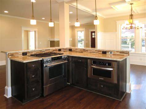 stove in kitchen island island with jennaire downdraft stove and counter microwave vision pointe homes