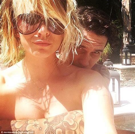 kaley cuoco chops her long locks in instagram pic upi com kaley cuoco poses topless with ryan sweeting s arms