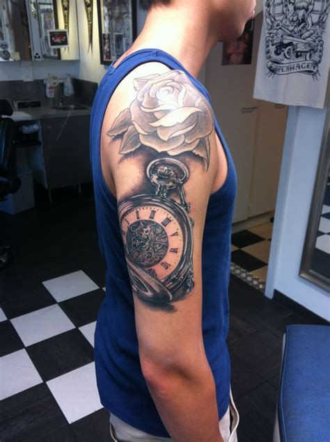rose and watch tattoo and pocket on half sleeve