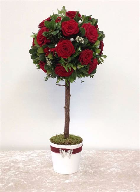 red rose topiary tree flower arrangement perfect for