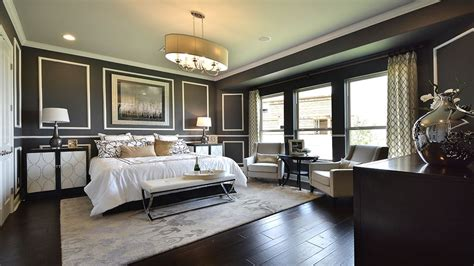 deco master bedroom with crown molding chandelier in