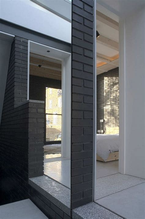 award winning small house in with a brick exterior