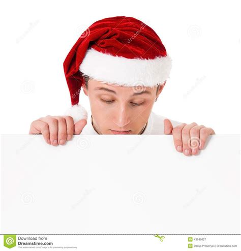 young man in santa hat stock photo image 43149627