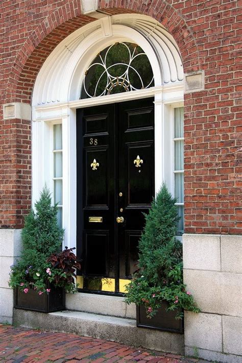 Black Kick Plates For Front Doors These Glossy Black Front Doors Make A Striking Contrast With The White Trim And Brass