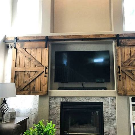 Barn Door Tv Cover Best 25 Tv Cover Up Ideas On Tv Covers Two Photo Frame And Tv Stand Cabinet