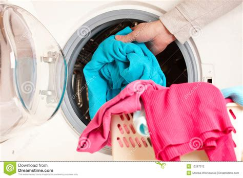 wash colored clothes in what water washing machine with colorful clothes stock photography
