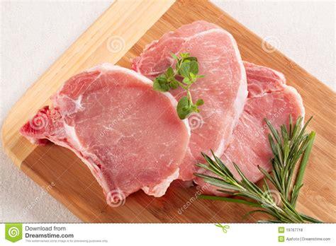 pork chops raw pork chops stock photo image of juicy herb board