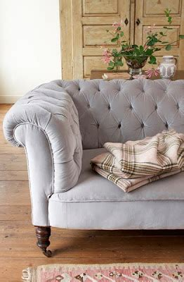 i want to reupholster my couch how to reupholster an ottoman and how to make a tufted ottoman