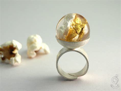 golden corn pop ring with a gold plated popcorn in a