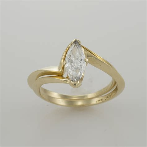 14k yellow gold 0 63ct marquise engagement ring