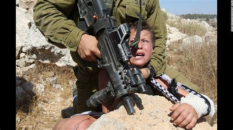 a worth living the story of a palestinian catholic books images show israeli soldier handling palestinian boy cnn