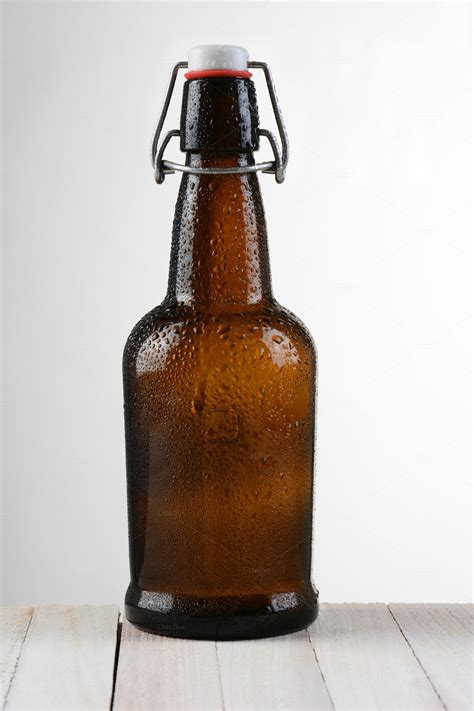 swing top beer swing top beer bottle light to dark food drink photos