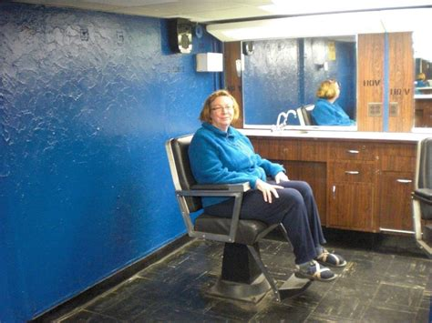female in barber chair getting buzzcut buzz cut for a woman in barbershop