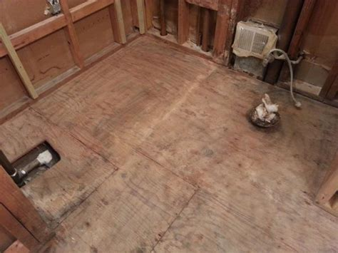 Best Way to Deal with this Subfloor issue in a bathroom