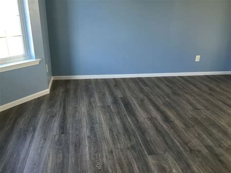 New Pergo Heather oak floors. Love it!!   Living room