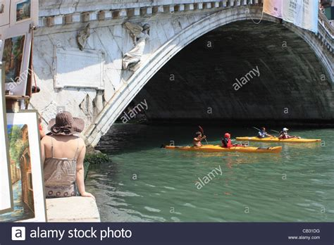 paddle boats on the canal ponte dei rialto stock photos ponte dei rialto stock
