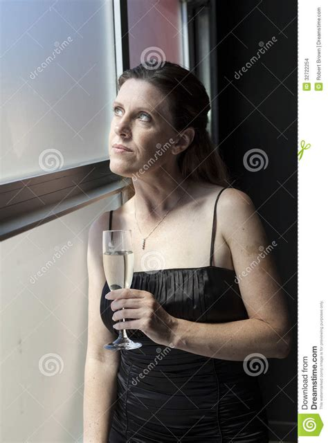 beautiful middle age black women middle aged woman in black dress with chagne stock