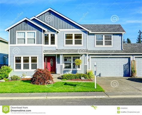 two story home big two story house view of entance porch and garage