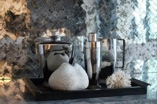 With a black bar tray accented with faux coral and chrome barware