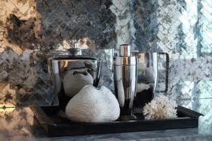 Chic bar area with antiqued mirrored herringbone tile backsplash over