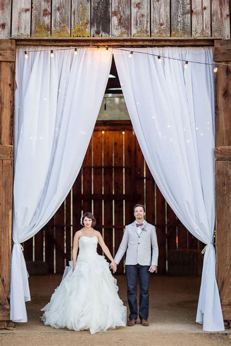 barn wedding venue with draped fabric for dramatic