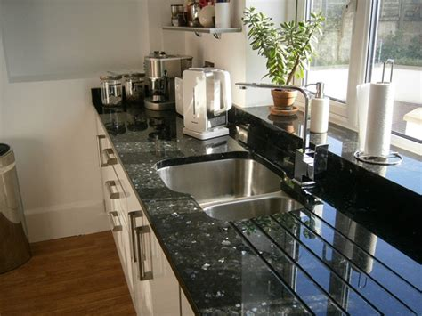 emerald pearl granite with white cabinets manicinthecity