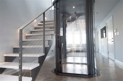 Dining Room Furniture Denver visi 48 glass elevator by nationwide lifts contemporary
