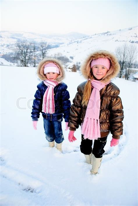 the snow sister two little sisters playing with snow outdoors stock photo colourbox