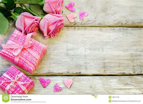 flowers and gifts s background with gifts and flowers stock photo
