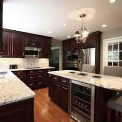 Espresso Kitchen Cabinets River White Granite With Espresso Cabinets Kitchen Pinterest Wood Cabinets Cabinets