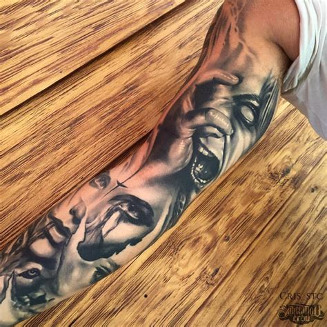 black and grey realistic sleeve from cris sake tattoo crew