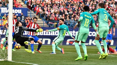 barcelona atletico madrid messi scores another late goal to send barcelona top of la